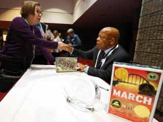 U.S. Congressman John Lewis signs copies of his award winning book March during the Morris Nonfiction Awards.
