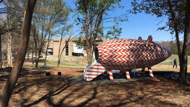 Pig-shaped play piece installed at N.C. Museum of Art