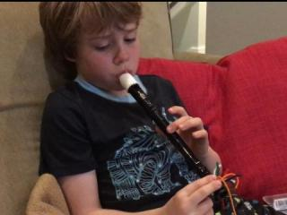 Julia Sims' son with his recorder.