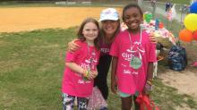 Girls on the Run coach Dona Aguayo with two team members