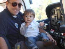 CAP volunteer Chris Bailey with son
