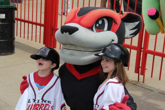 Fly Squirrels mascot Nutzy with fans