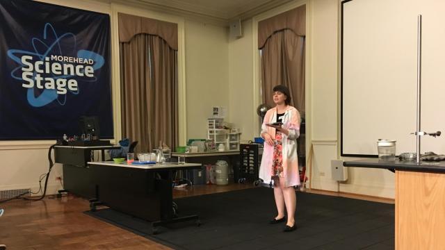 Rachel Bridges, a rising senior at Carolina, leads a Science Live! program on Morehead's Science Stage.