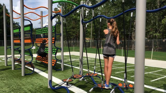 """Elevate Fitness Course, a circuit of """"ninja warrior"""" style obstacles, may have opened in July in Apex, but work is still being done to fine tune the course and design programs to help people use it. A pilot group of teens is helping to develop programs."""