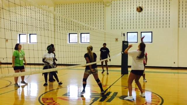 Amanda Lamb's daughter leads volleyball camp in downtown Raleigh.