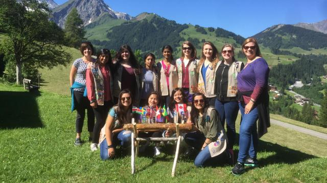 Michelle Le, far right with blue and pink shirt, with her Girl Scout troop and co-leader during a recent trip to the Swiss Alps.