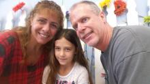Debbie Sawyer, owner of North Hills' Flour Power Kids Cooking Studio, with her husband and daughter