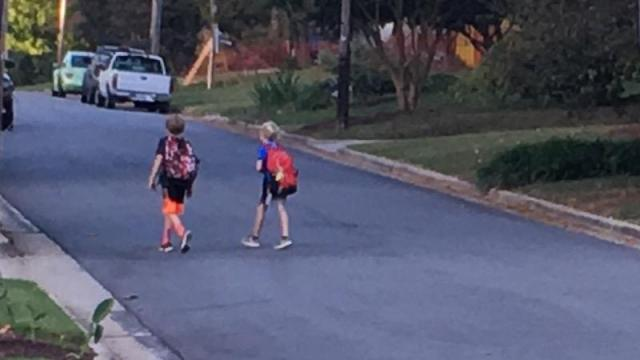 Julia Sims son and friend head to school.