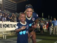 NC Courage forward Jessica McDonald with son Jeremiah