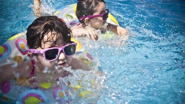 Kids in a swiming pool