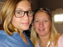 Marie McCartney (right) with daughter Evelyn, a student at Wake Early College for Health and Sciences