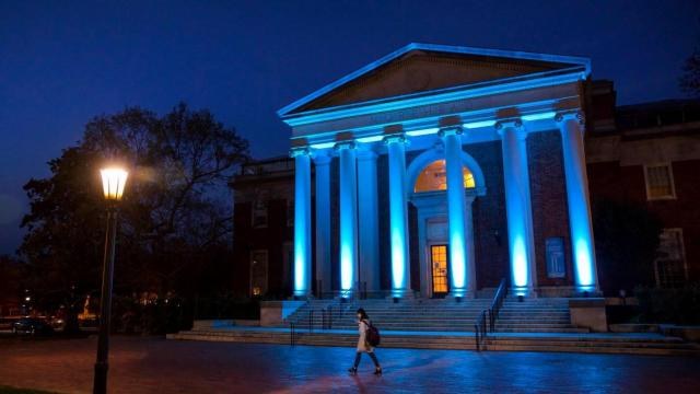 The Morehead Planetarium and Science Center building is lit up in light blue on the University of North Carolina at Chapel Hill campus in support of Autism Awareness Day on April 2, 2018. (Johnny Andrews / UNC-Chapel Hill)