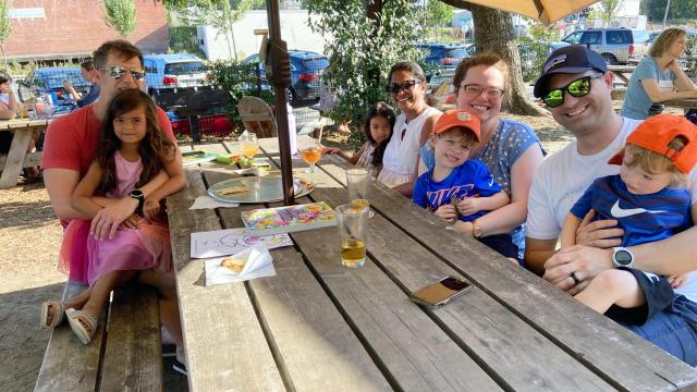 The Sellers family (left) joins the Rietz family (right) at Ponysaurus Brewing Company in Durham.