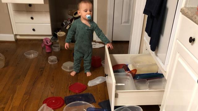 Tara Lynn's son enjoys emptying out the kitchen drawers.