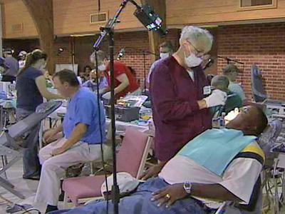 Volunteers with North Carolina Missions of Mercy give free dental care to patients at Stewartsville Baptist Church in Laurinburg.