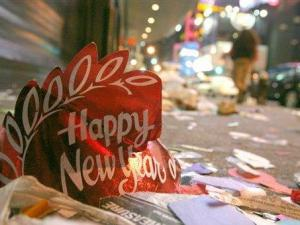 A New Year's Eve hat, confetti, and other debris from New Year's Eve festivities is seen on a side street sidewalk in New York's Times Square early morning in this Saturday, Jan. 1, 2005 file photo. (AP Photo/Tina Fineberg, FILE)