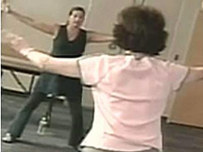 Camille Kittrell (left) teaches Tai Chi to Parkinson's patients to help them loosen and relax their bodies.