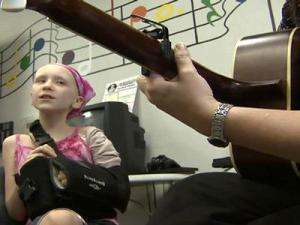 Eleanor Bothwell, 9, of Raleigh, and music therapist Elizabeth Fawcett perform a song Eleanor wrote about her experience fighting cancer. Eleanor took part in music therapy offered by Fawcett at the North Carolina Children's Hospital.