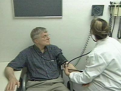 Paul Johnson gets his blood pressure checked.