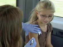 Katie Weppler, 11, receives her Tdap immunization in Wilson.