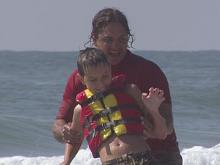 Surfing therapy helping children with autism