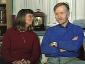 Karen Berry sits next to her husband, Walter Hartel, who was diagnosed with Alzheimer's disease four years ago.