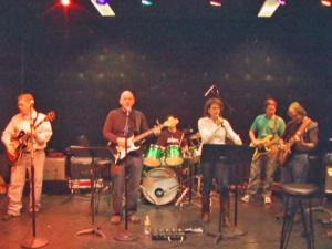 The band N.E.D. performs rock music at night, and during the day, its members serve their communities as gynecologic surgeons, fighting cancer in women.