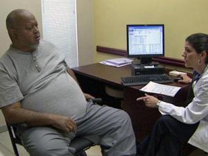 Johnny Odom consults with Duke Family Medicine's Dr. Gloria Trujillo.