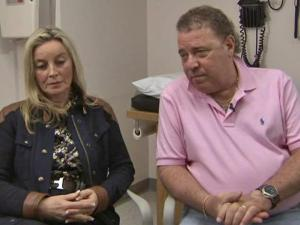 Alan Ferraro, 60, of New Haven, Conn. (left), accompanied by his wife Jola, talks about a life-saving treatment for a brain tumor he received at Duke University Hospital.