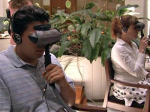 People at the legislative building try out virtual equipment used to simulate a psychotic episode experienced by schizophrenia patients.