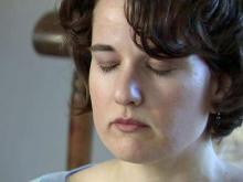 Alison Davies meditates to relieve her stress.