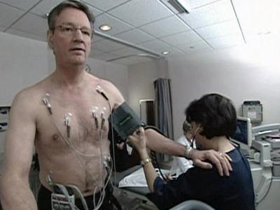 A doctor examines a patient as part of a research study.