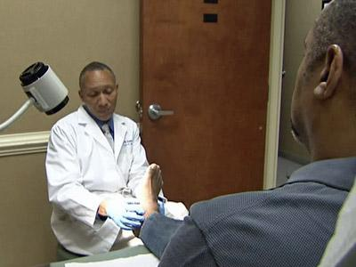 Stanley Evans has his foot examined for skin cancer.