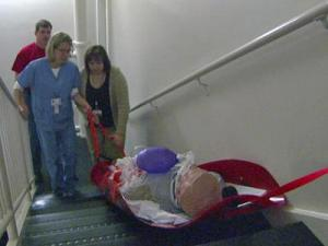 WakeMed employees practice using the Med Sled, which is used to evacuate patients in case of emergency.