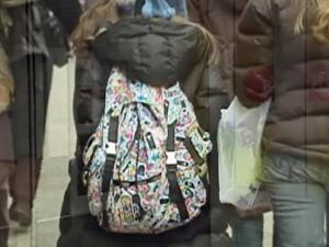 Heavy backpacks can weigh on students, a study shows.