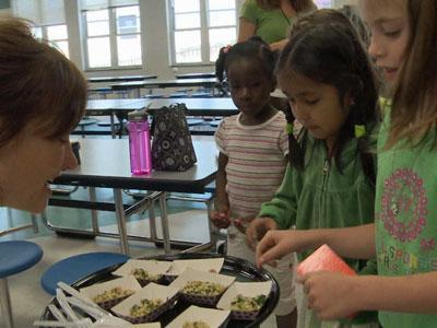 McDougle Elementary School students sample the recipe - Stir-Fried Green Rice, Eggs and Ham.