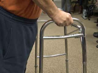 Richard Wall uses a walker.