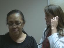 Dr. Mimi Miles checks on patient Katherine Chavis.