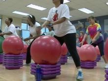 Drummers pound way through fitness class