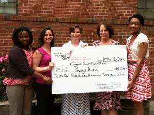 Representatives of the Orange County Health Department accept a grant from the Susan G. Komen for the Cure, NC Triangle to the Coast Affiliate.