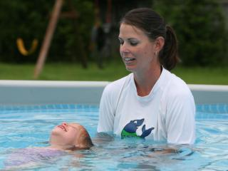 Natalie Monk takes an Infant Swimming Resource class with instructor Kelly Champon.