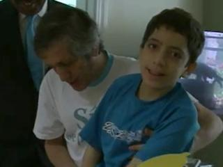 Lautaro Javier is able to take a few steps with the help of his father after receiving a stem cell transplant at Duke.