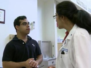 Ishan Munshi, a resource specialist at the Lenox Baker Children's Hospital at Duke, has Down syndrome. He's an inspiration to others with the genetic disorder, who are living longer, better lives thanks to advances in medical care.