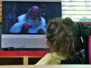 Lili Frazier did not get to sit on Santa's lap. Instead, she visited him on his laptop. (Photo by Rick Armstrong)