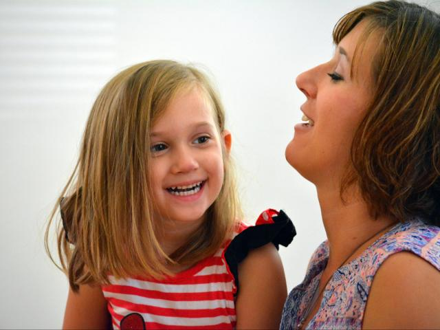 Rebecca Lynn Waite, 3½, laughs with her mother, Heather Waite, in their Raleigh home. <br/>Photographer: Kelly Hinchcliffe