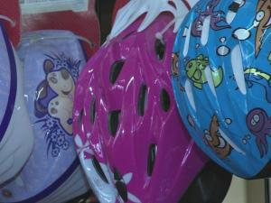 Right now is a great time for cycling for both adults and children, but a lot of kids are missing a key piece of safety gear when they ride: a helmet.