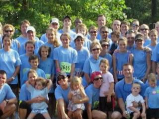 One of the most successful fundraising teams at the Race for the Cure does it in memory of Kristi Walker, whose smiling face is on the team's Carolina Blue shirts.