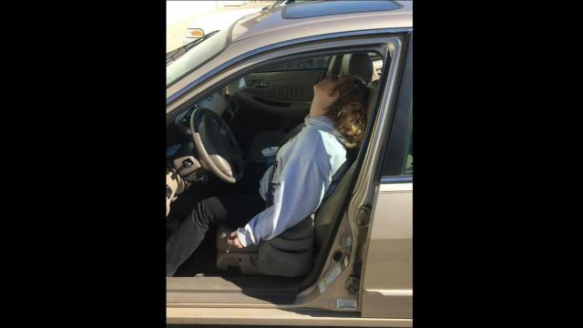 Police snapped this photo of an Indiana mother passed out in her car last year. The 26-year-old Indiana woman says she has been clean since that day, doting on her son and working a full-time job.