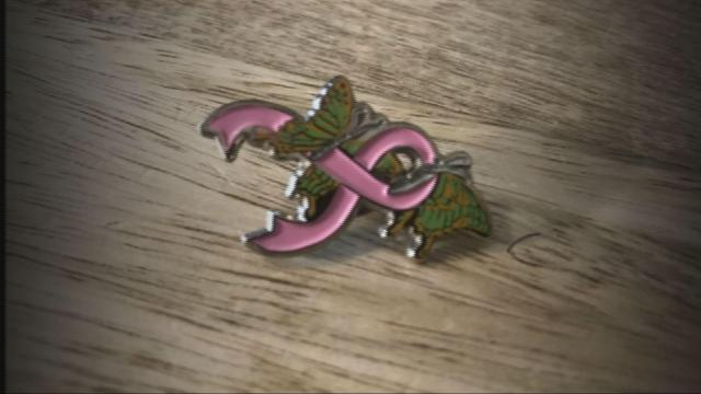 Blayde had this pin designed and created to inspire other women in their breast cancer fight
