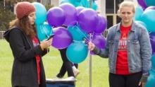 IMAGES: Annual survivors walk a touchpoint for families after a suicide